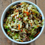 stir fry pork cabbage carrots egg roll in a bowl